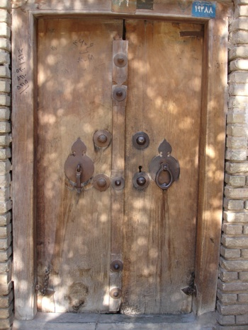 a male door knocker on left a female one on right & in Yazd   Ricardo Pinto